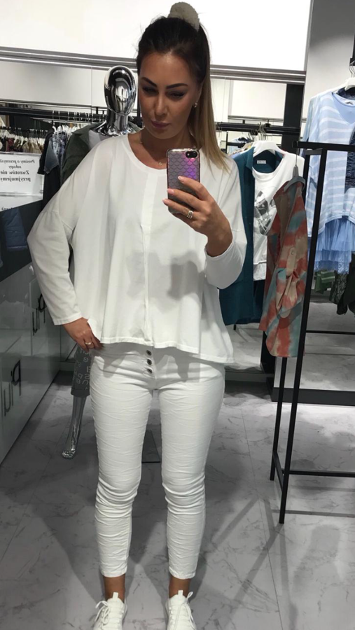 Biała bluzka o kroju oversizowym ze szwem z przodu