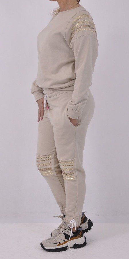 Spodnie beżowe z ozdobnymi nitami M/L