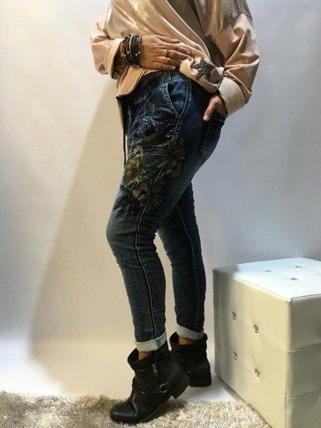 Spodnie jeans w kwiaty M